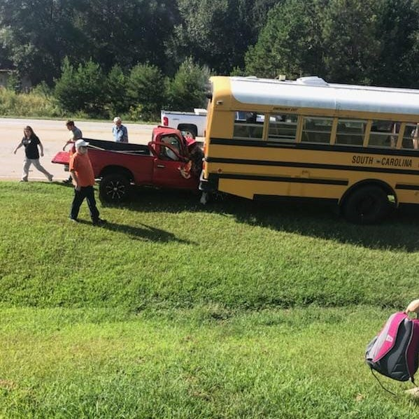 School bus involved in wreck with pickup truck near Starr, roadway blocked
