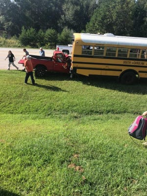 A school bus and a pickup truck were involved in a collision near South Carolina 81 and Woodson Drive on Tuesday afternoon.