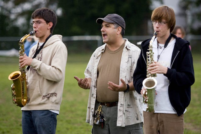 In this Asbury Park Press file photo from Oct. 18, 2006, Alan Abraham, director of the Manasquan High School marching band, coaches its members.