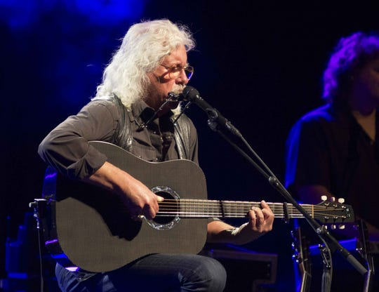 Arlo Guthrie performs during the Arlo Guthrie: Alice's Restaurant 50th Anniversary Tour at the Ferst Center For The Arts on Saturday, Jan. 31, 2015, in Atlanta.