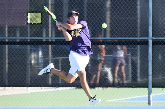 Wylie's Lane Adkins hits a shot during a District 4-5A match against Aledo earlier this season. The 12-7 win was a wake-up call for the Bulldogs and a match they have learned from entering the postseason.