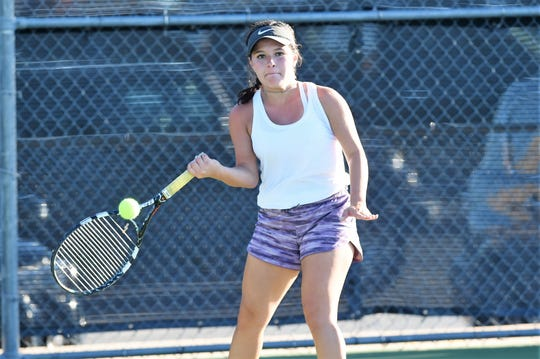 Wylie's Analeah Elias hits a shot during a 12-7 win against Aledo early in the season. The Bulldogs were challenged on their way to the District 4-5A championship and know tough matches will continue throughout the playoffs.