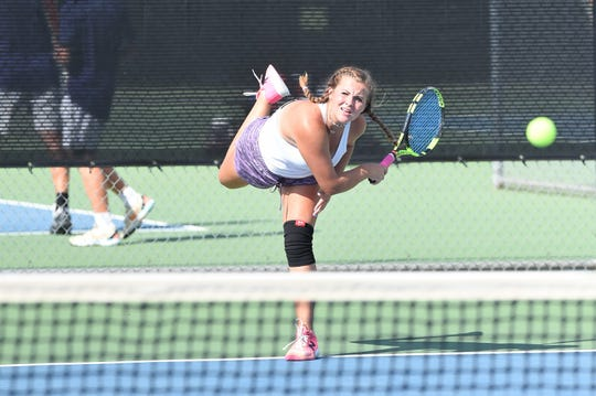 Wylie's Hailey Parker follows through on a serve during her girls doubles match with Rebecca Yates against Aledo on Monday, Sept. 24, 2018. The Bulldogs won 12-7.