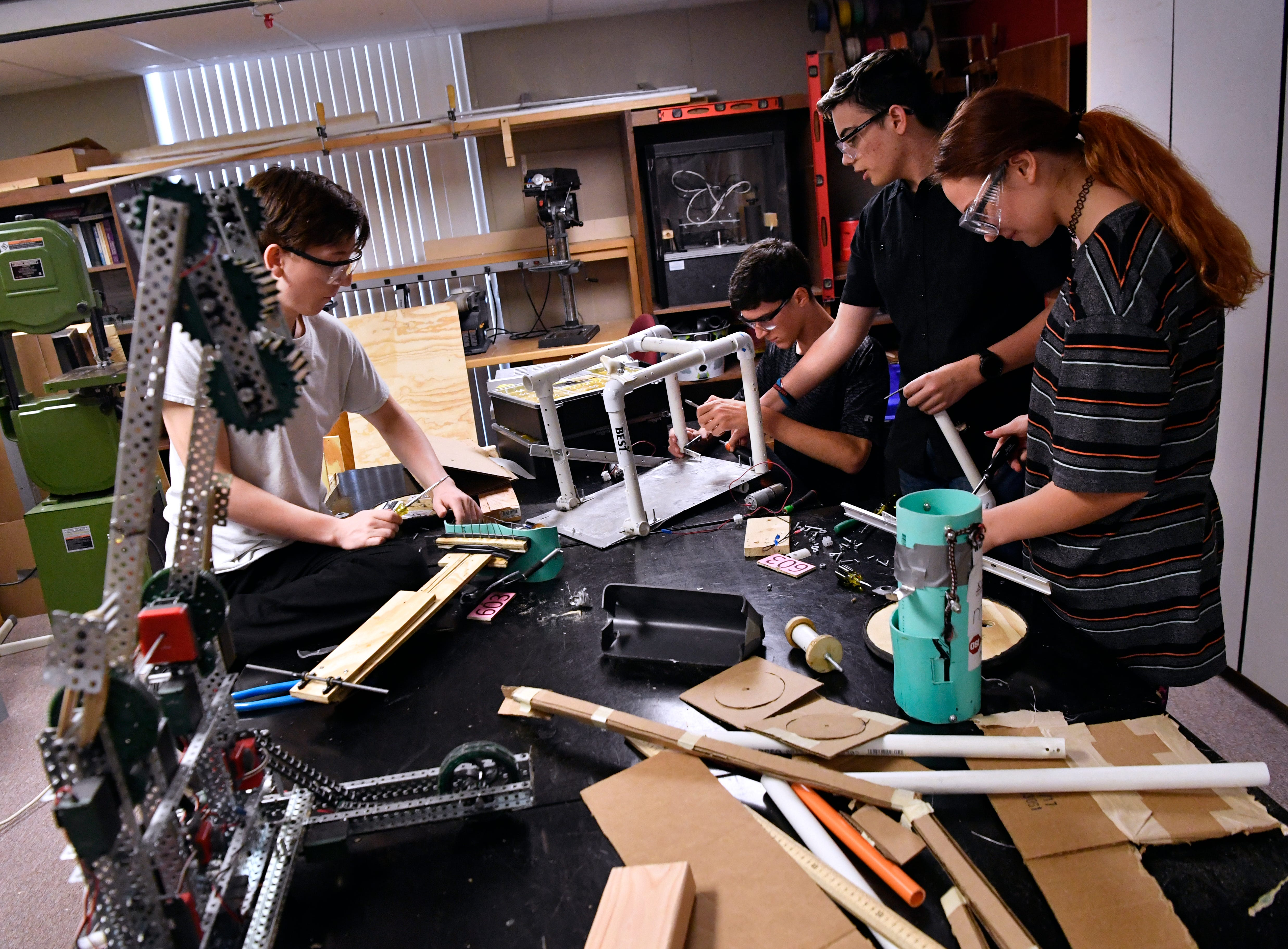 Robotics students disassemble a robot from last year Tuesday at ATEMS. The students recycle some of the material but will fabricate their robots this year from scratch.