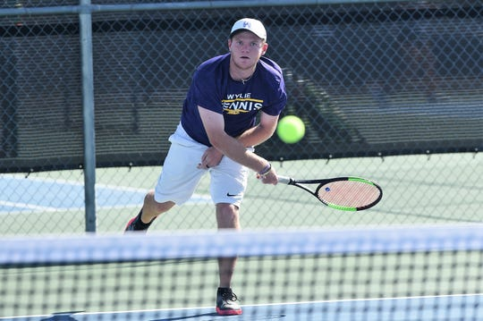 Wylie's Cole Edwards follows through on a serve during a boys doubles match with Aric Richardson against Aledo on Monday, Sept. 24, 2018. Edwards and Richardson won 6-1, 6-1 as the Bulldogs won 12-7.
