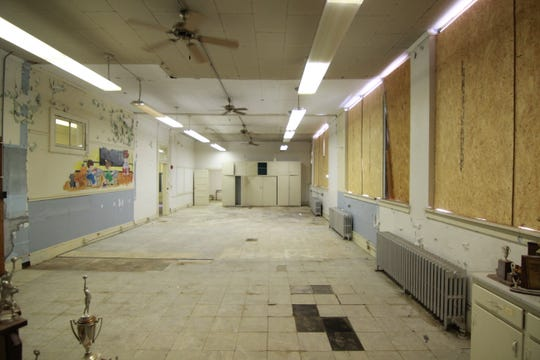 With plans to keep as many existing walls as possible, a roughly 800-square foot space inside the old school could be a one-bedroom apartment.