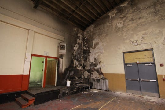A fire in 2015 burned a corner of the Mars Hill High School gym.