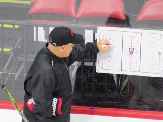 Binghamton Devils coach Mark Dennehy diagrams a play during Tuesday's practice at Floyd L. Maines Veterans Memorial Arena.