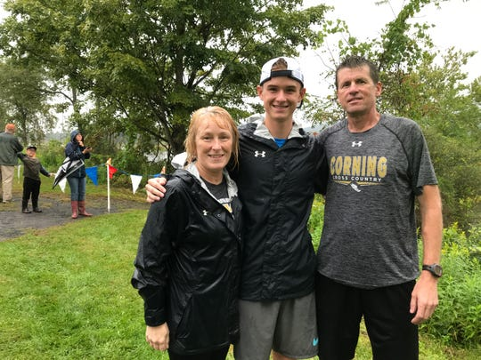 Sue Stage-Derick and her husband, Jim Derick, with their son, Bryce, a senior cross-country runner at Corning-Painted Post High School.