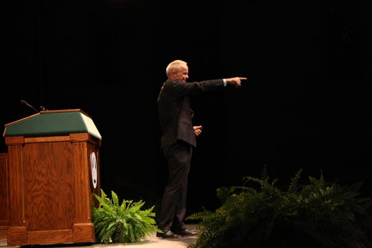 Binghamton University President Harvey Stenger calls out to an audience member during his State of the University address on Sept. 25.