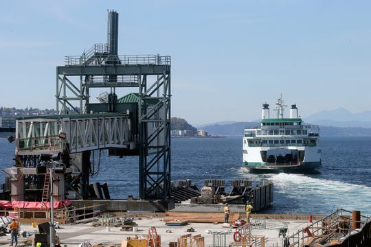 Loading areas for Bremerton and Bainbridge ferries at Colman Dock in Seattle will swap this week as part of the construction.The dock construction as the Chimacum leaves for Bremerton on Tuesday, September 25, 2018.