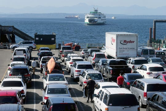 Cars wait to board a ferry at Colman Dock in Seattle on Tuesday. Construction there will force changes to loading areas, starting Wednesday.