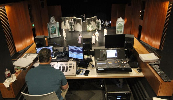 Dale Borer watches a rehearsal from the tech booth of the William D. Harvey Theatre.