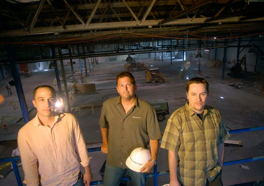 From Left, Mike Lane, chief operations officer, Mark Bonfigli, president/CEO, and Rick Gibbs, chief technical officer,  standing in 2007 in what will be their new office space in the former Specialty Filaments building on Pine Street. (RYAN MERCER, Free Press)