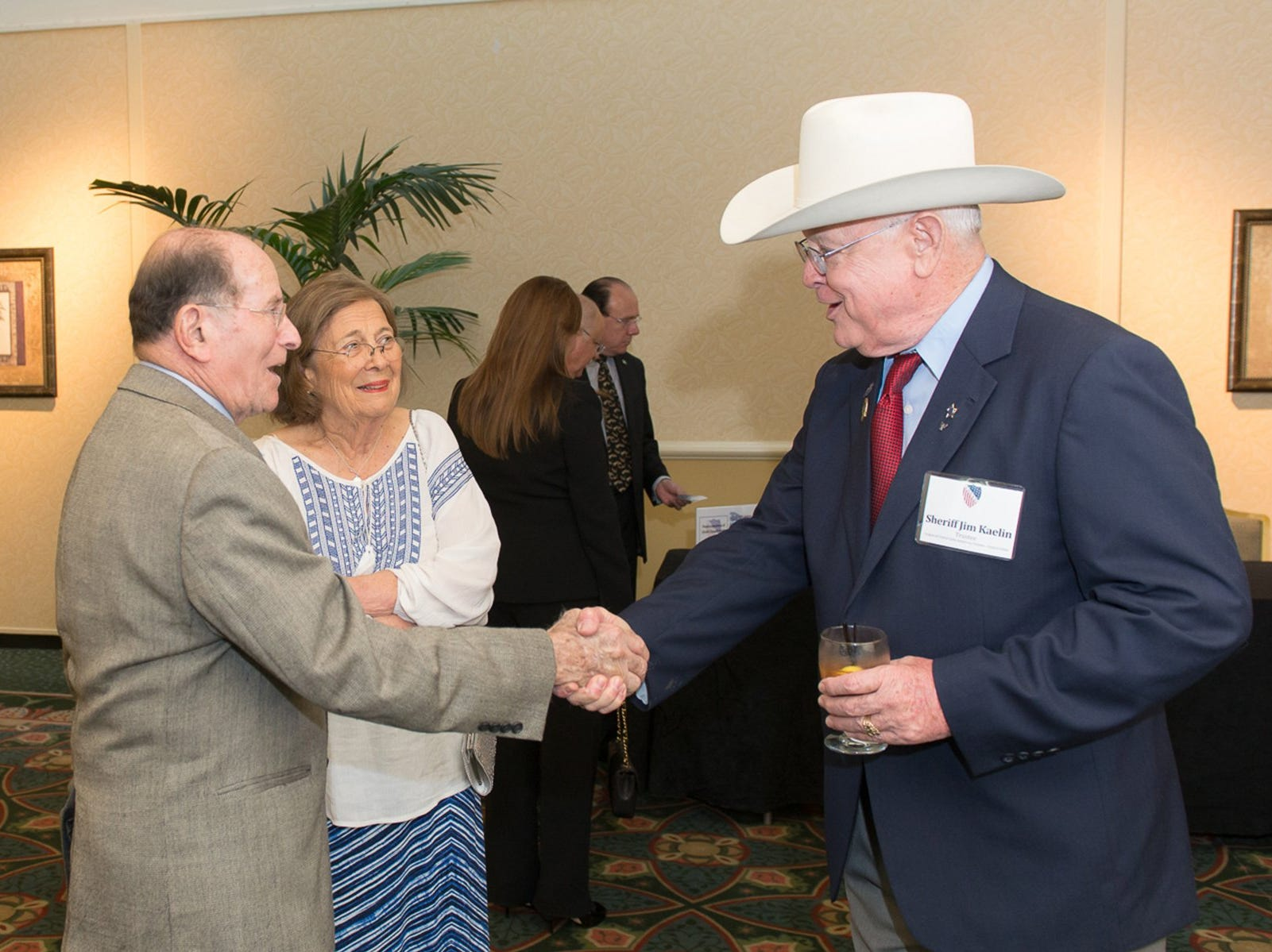 Dr. Oscar Garcia(left) greets Sheriff Jim Kaelin during the 2014 LULAC Banquet, held Thursday at the Omni Bayfront Hotel in Corpus Christi. Banquet honored outstanding parent role models in our community.