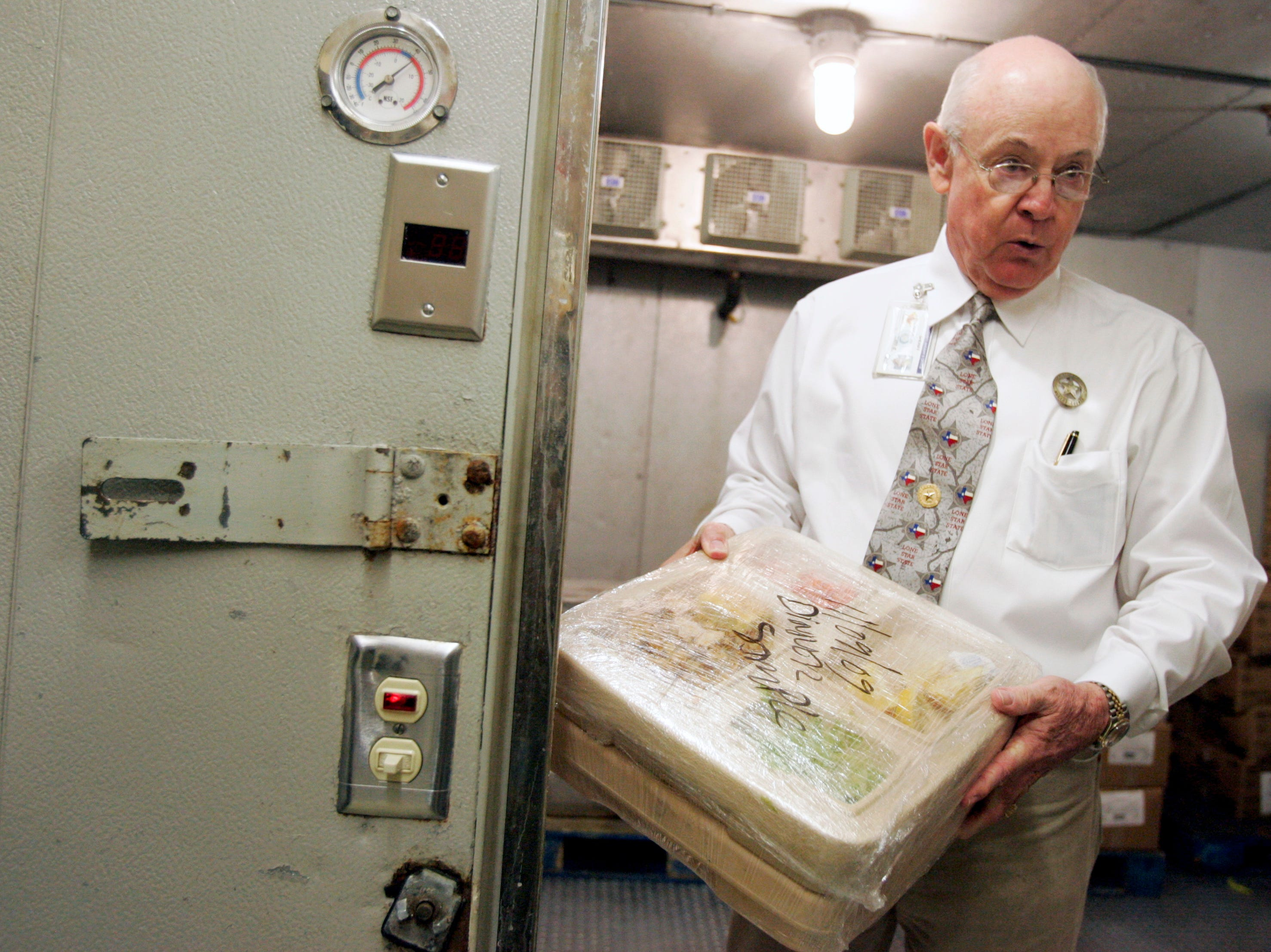 Sheriff Jim Kaelin holds up one of the meals they fed to prisoners, which they label and save for testing in case their is a food illness, Thursday, Nov. 12, 2009 at the Nueces County Jail in Corpus Christi.