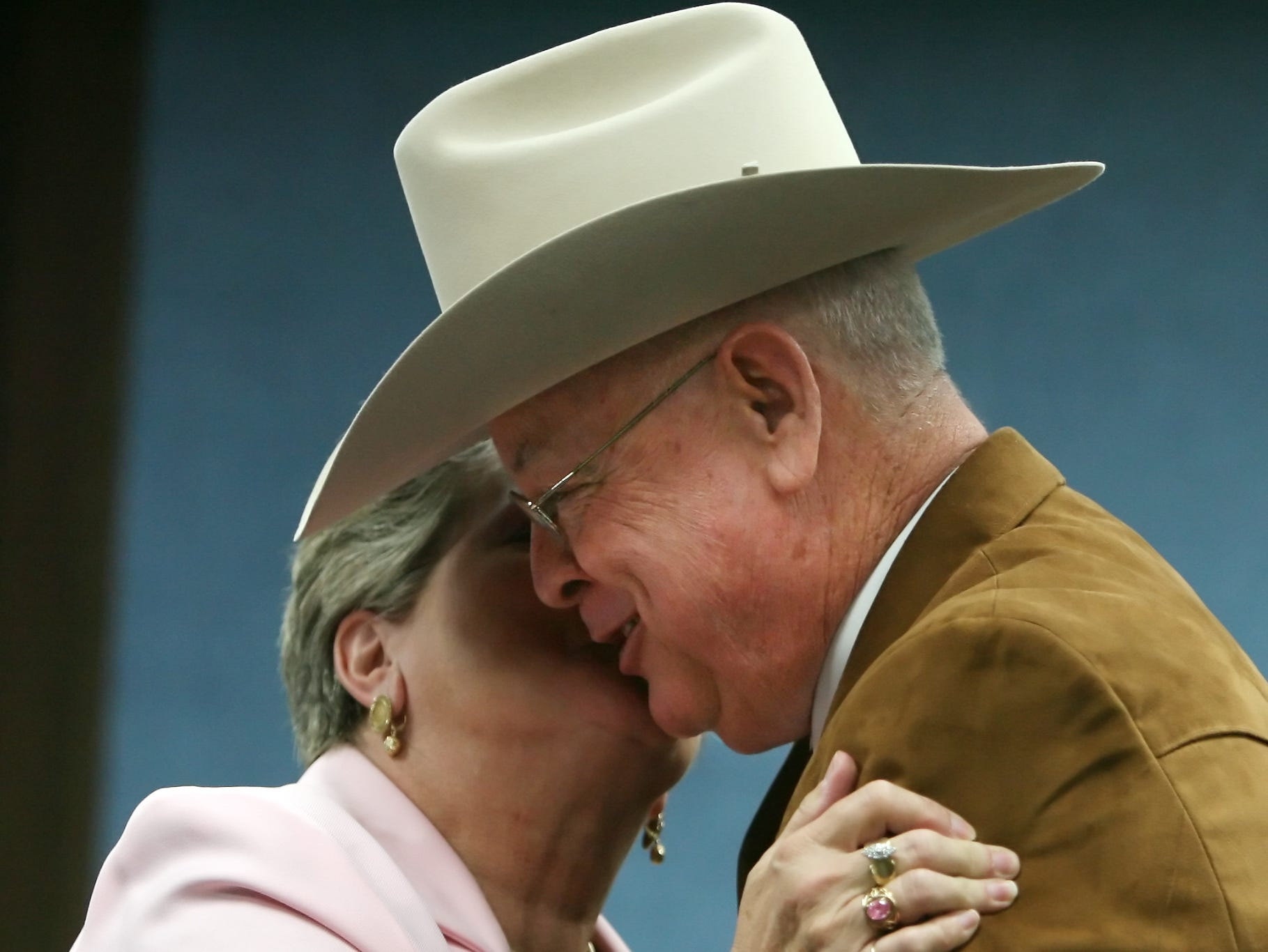 Newly elected Nueces County Sheriff Jim Kaelin (right) and his wife, Sharon Kaelin, embrace after he is sworn in at the Nueces County Courthouse on Friday. (11/17/06)