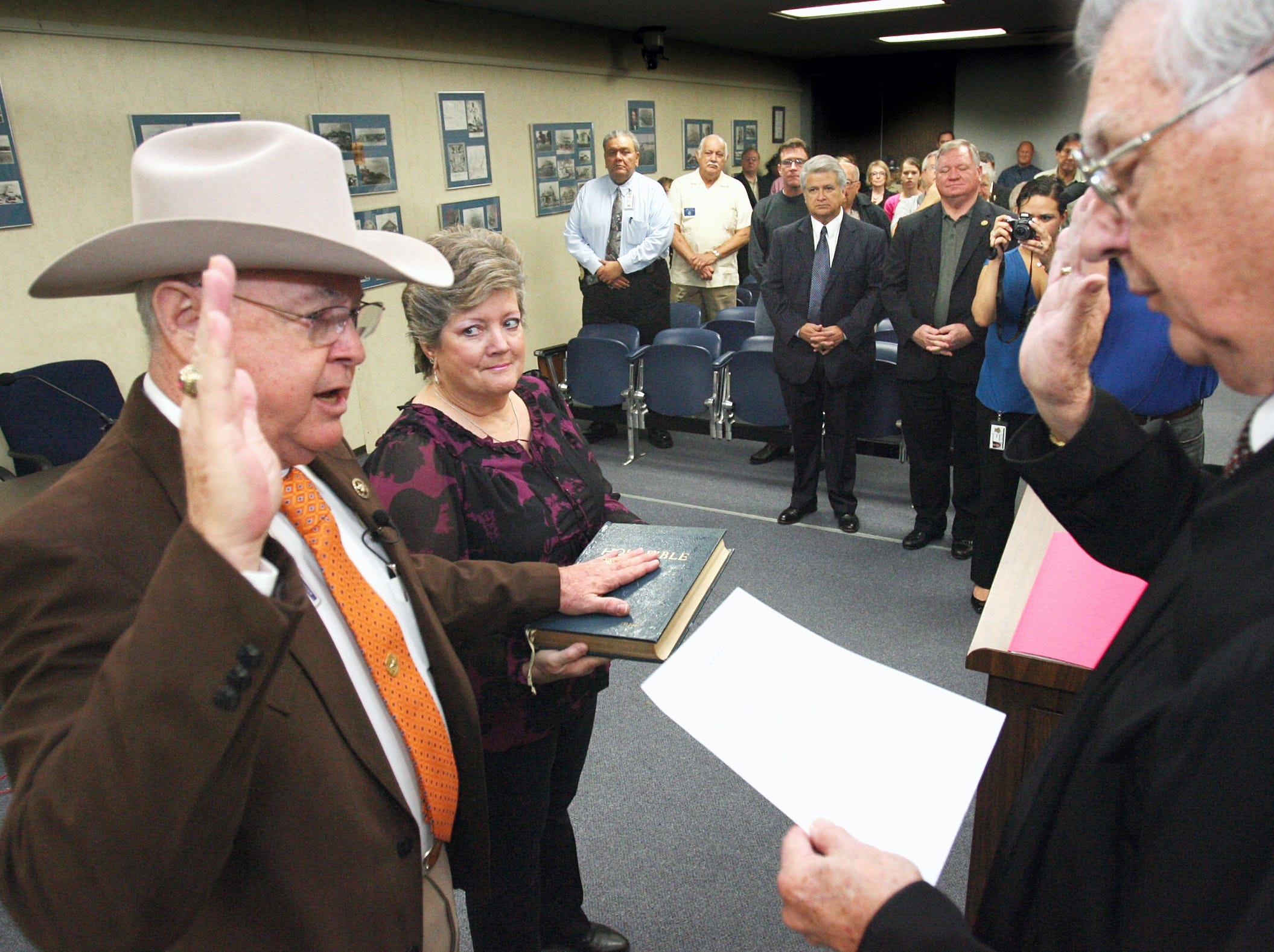 Sheriff Jim Kaelin was sworn into office Monday morning at the commissioners courtroom at nueces county courthouse by county judge Loyd Neal while sheriff's wife, Sharon Kaelin, holds the family bible.  About 150 people showed up to witness and also to share cake in the sheriff's office community room.
