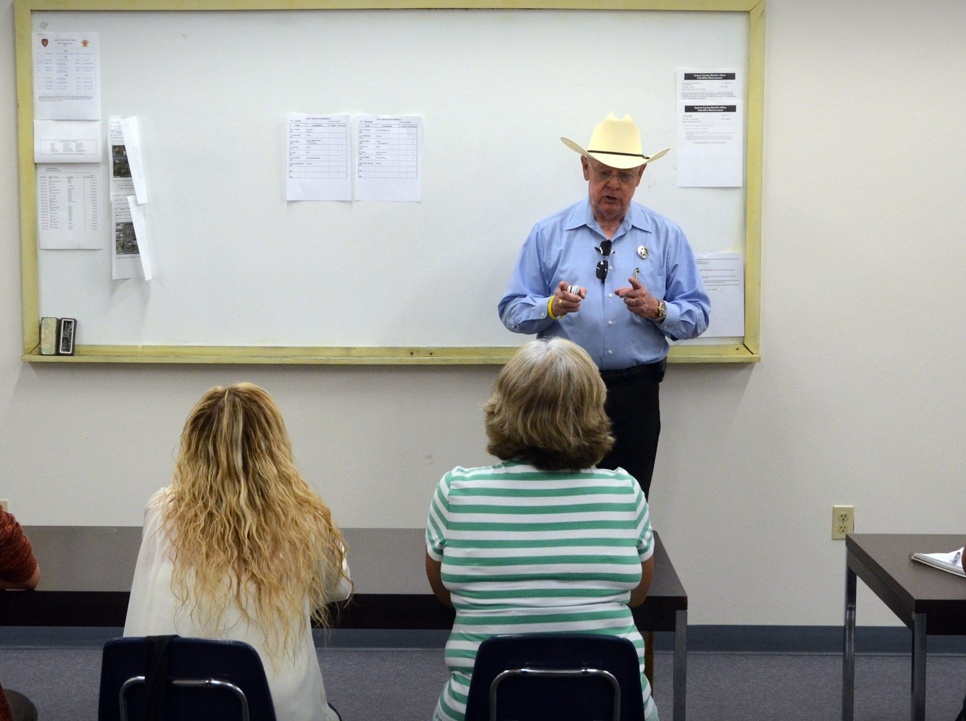 Nueces County Sheriff Jim Kaelin talking with local middle and high school teachers and couselors, learning about the Nueces County Sheriff's Office Alternative Incacerations and Jail Industries Programs, during a visit to the Nueces County's McKenzie Jail Annex.