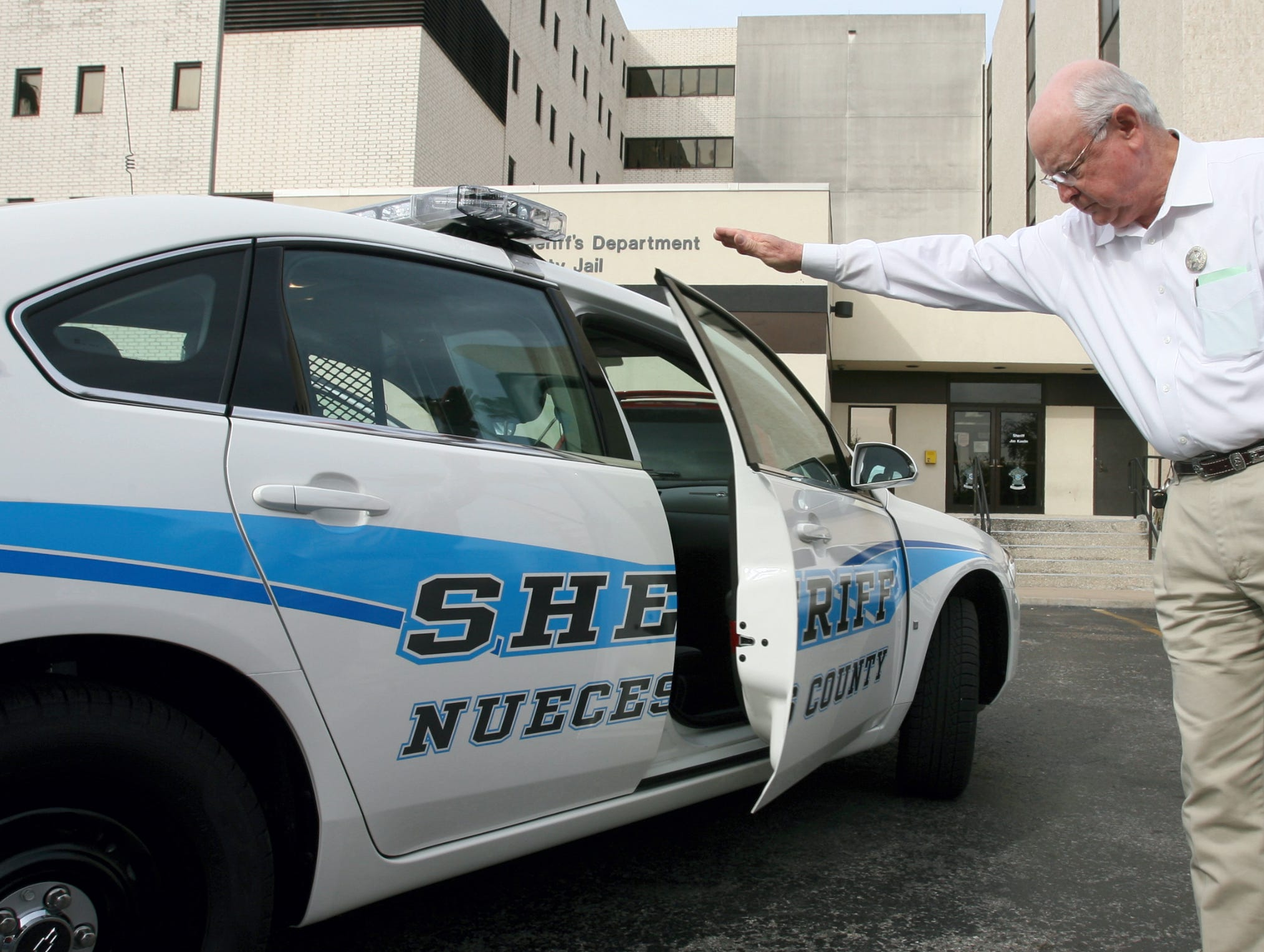 Sheriff Jim Kaelin shows off one of two new patrol cars that were put in commission on Friday. The cars are two of six new Chevy Impala cars that are striped with the new colors of the Nueces County Sheriff's Office (Kaelin said they're changing to office instead of department) and represent the new vision of the office.
