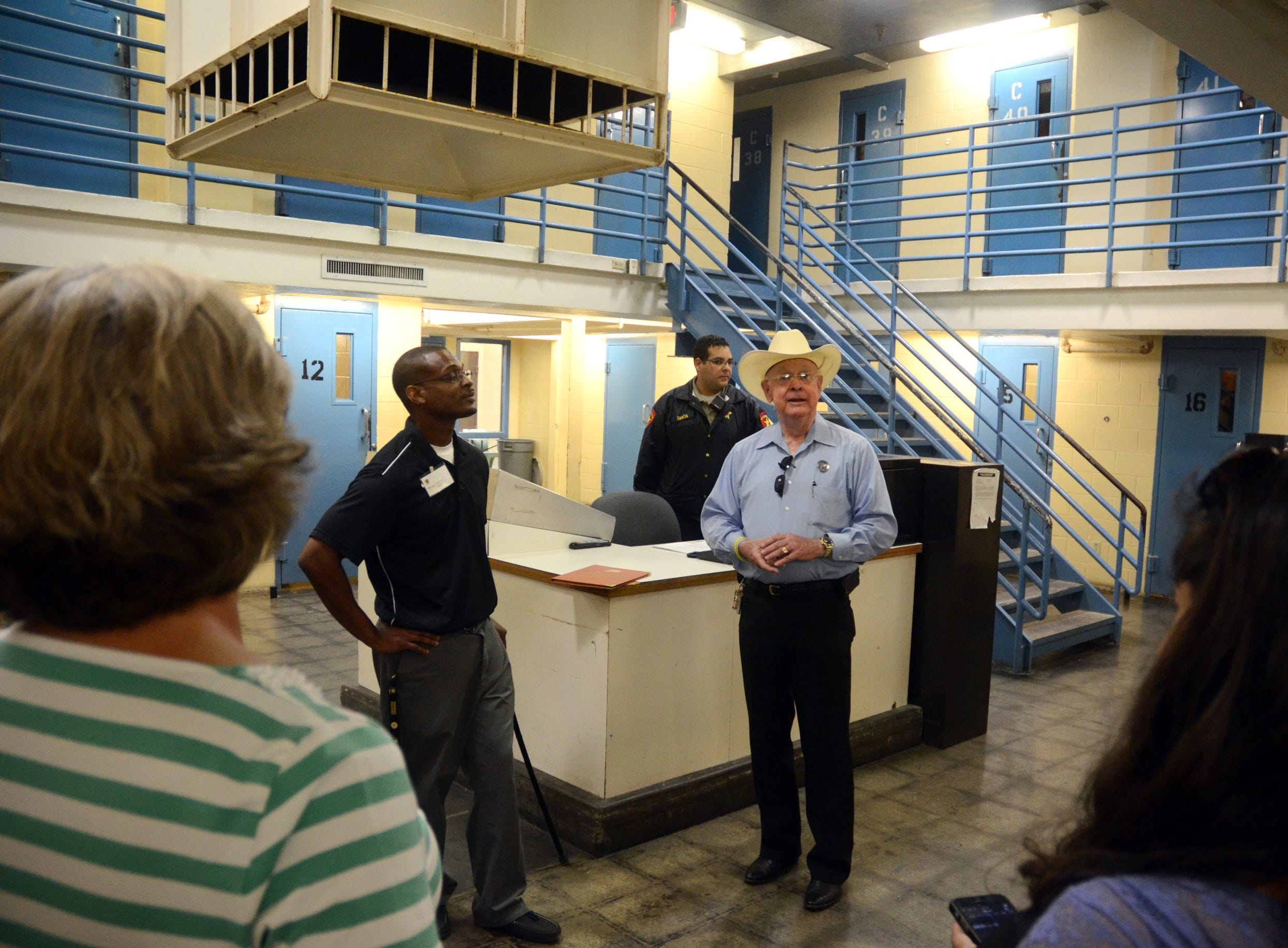 Nueces County Sheriff Jim Kaelin (middle with hat) talking to 5 local middle and high school teachers and couselors in one of the jail areas where they have 28 inmates housed in individual cells. They were there to learn about the Nueces County Sheriff's Office Alternative Incacerations and Jail Industries Programs, during a visit to the Nueces County's McKenzie Jail Annex.