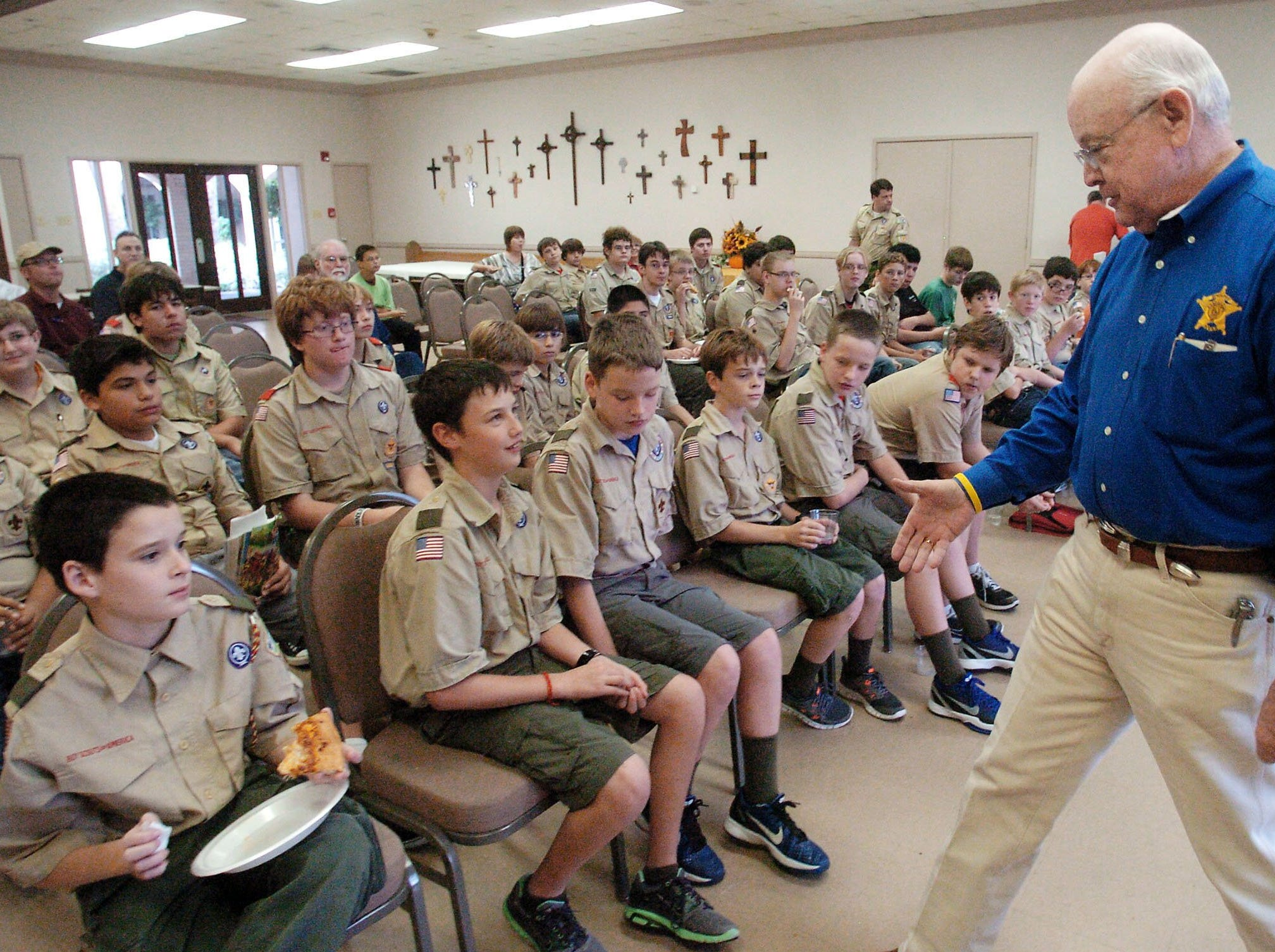 Nueces County sheriff, Jim Kaelin, was the keynote speaker to about 40 boy scouts from Troop #2 at First Presbyterian Church on Carancahua st. on Saturday morning.  This was part of  the troop's 100 years of existence celebration.  A workshop was held in the morning and then Sheriff Kaelin arrived at noon to be their keynote speaker.  Here kaelin introduces himself to the scouts and teaches them what it means when somebody shakes peoples hands.