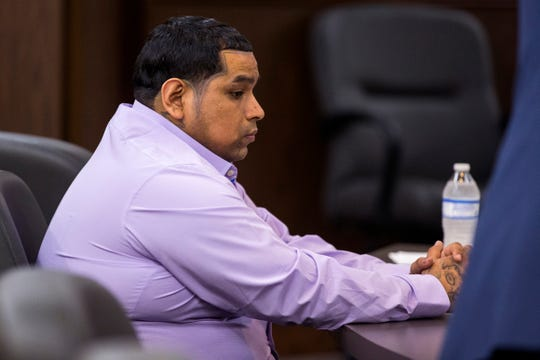 Defendant David Davila (left) waits for trial to begin in the 105th District Court on Tuesday, September 25, 2018. Davila, charged with capital murder, is accused in the fatal shooting of 13-year-old Alex Torres. Opening statements were given in the trial Tuesday.