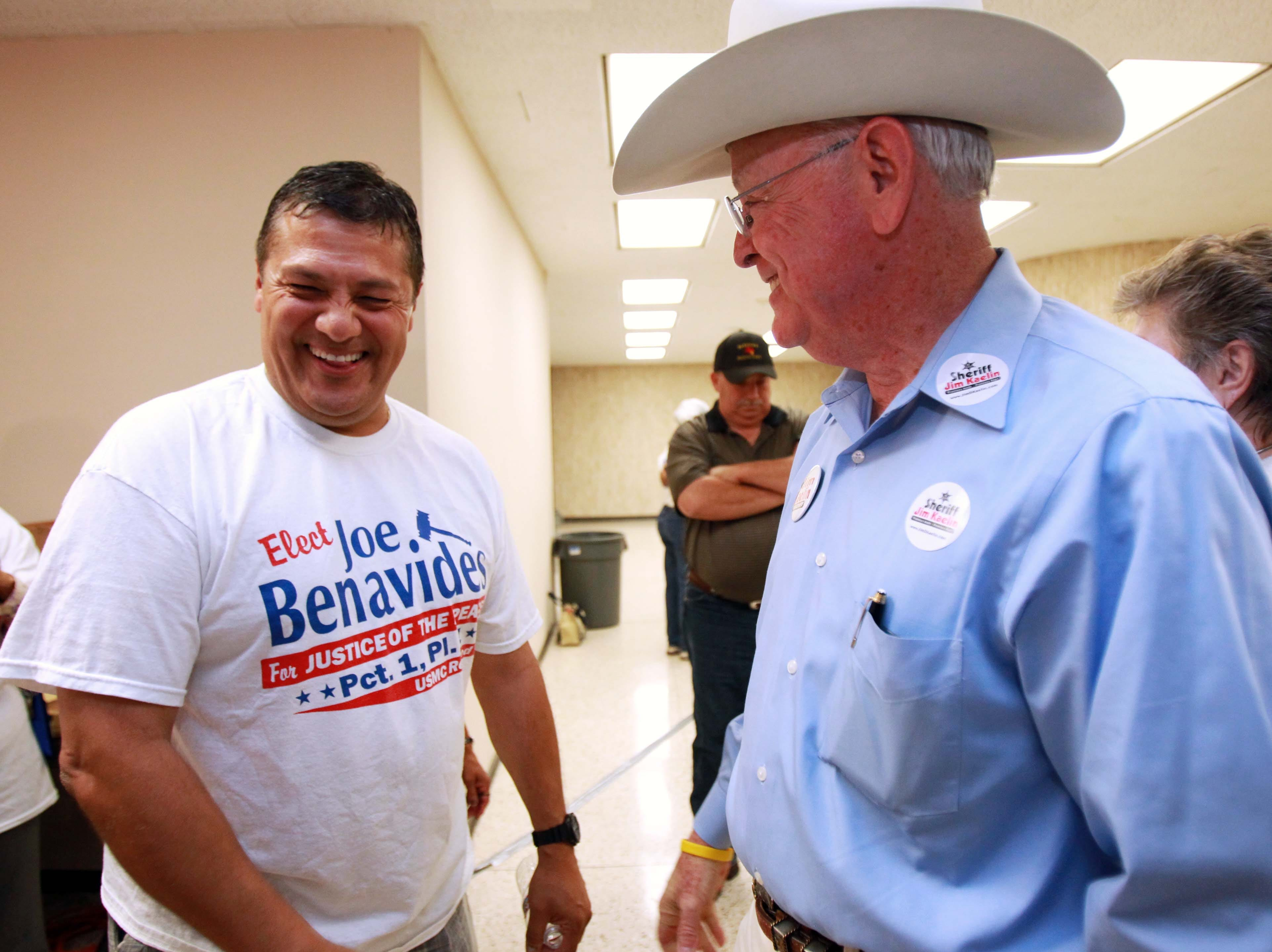 Justice of the Peace candidate Joe Benavides (left) laughs as he and Sheriff Jim Kaelin celebrate their wins Tuesday, Nov. 6, 2012 at the Nueces County Courthouse in Corpus Christi.
