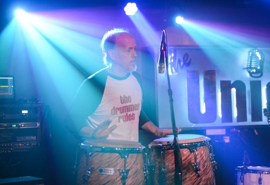 Steve Wendland plays the conga drums during an open mic night at The Union Firehouse in Mount Holly.