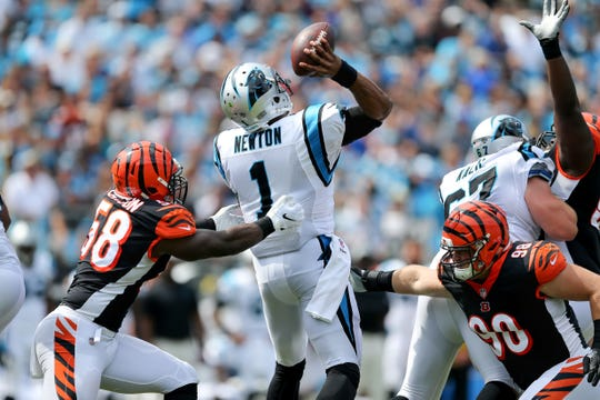 Cincinnati Bengals defensive end Carl Lawson (58) and Cincinnati Bengals defensive tackle Ryan Glasgow (98) pressure Carolina Panthers quarterback Cam Newton (1) as he throws in the first quarter during a Week 3 NFL game between the Cincinnati Bengals and the Carolina Panthers, Sunday, Sept. 23, 2018, at Bank of America Stadium in Charlotte, North Carolina.