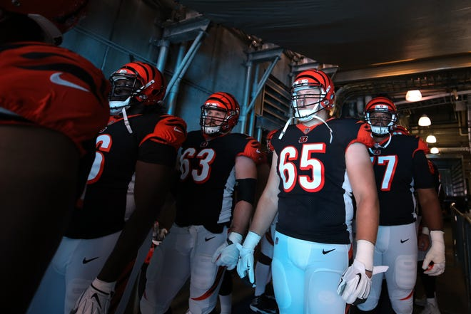 Cincinnati Bengals offensive tackle Clint Boling (65) and the offensive line get set to take the field before a Week 3 NFL game between the Cincinnati Bengals and the Carolina Panthers, Sunday, Sept. 23, 2018, at Bank of America Stadium in Charlotte, North Carolina.