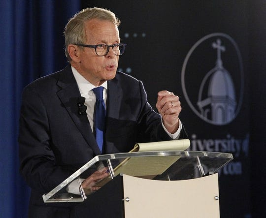 In this Sept. 19, 2018, file photo, gubernatorial candidate, Republican Mike DeWine, speaks during a debate with his opponent Democrat Richard Cordray at the University of Dayton in Dayton, Ohio. Letters from the physicians of DeWine and Democrat Richard Cordray were produced at the request of The Associated Press. The two are in a close, expensive race this fall to replace Republican Gov. John Kasich, who's term-limited.