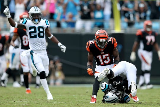 Carolina Panthers cornerback Donte Jackson (26) collects an intercepted pass intended for Cincinnati Bengals wide receiver John Ross (15) in the fourth quarter during a Week 3 NFL game between the Cincinnati Bengals and the Carolina Panthers, Sunday, Sept. 23, 2018, at Bank of America Stadium in Charlotte, North Carolina. Carolina won 31-21.