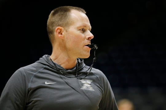 Xavier Musketeers head coach Travis Steele directs his team during the first practice of the season at the Cintas Center in Cincinnati on Tuesday, Sept. 25, 2018.