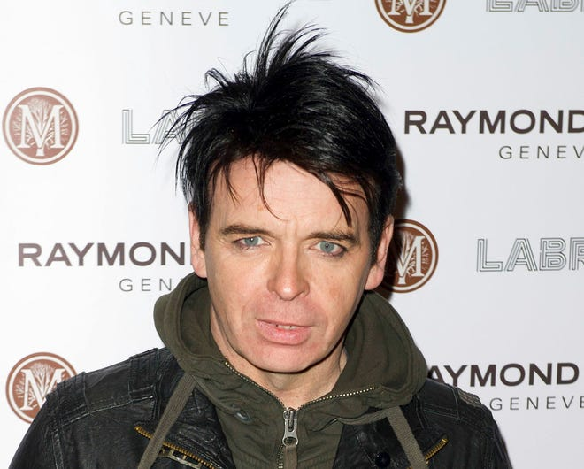 FILE - In this Jan. 26, 2012, file photo, British singer Gary Numan arrives for the Pre-Brit Awards Dinner at a London venue. Police say a tour bus carrying Numan struck and killed a 91-year-old man in Cleveland, on Monday, Sept. 24, 2018. Authorities say Numan's tour bus was making a right turn when it struck the victim as he walked in a crosswalk. (AP Photo/Jonathan Short, File)