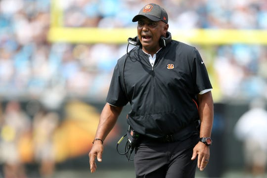 Cincinnati Bengals head coach Marvin Lewis congratulates the team after scoring a touchdown in the first quarter during a Week 3 NFL game between the Cincinnati Bengals and the Carolina Panthers, Sunday, Sept. 23, 2018, at Bank of America Stadium in Charlotte, North Carolina.