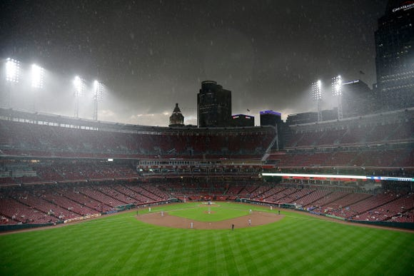 Heavy rain begins to fall in the third inning of the MLB Interleague game between the Cincinnati Reds and the Kansas City Royals at Great American Ball Park in downtown Cincinnati on Tuesday, Sept. 25, 2018. The game was stopped for a rain delay in the third inning, with the Royals leading 1-0.