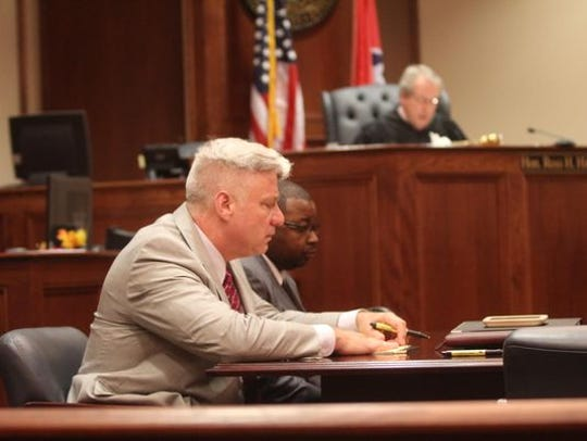 Barry McCoy, center, and his attorney, Ed DeWerff, listen as Judge Ross Hicks acquits McCoy of seven counts of child rape in August 2015. He is now facing new charges involving a different child.