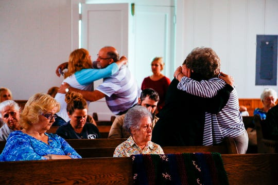 Friends and family mourn for Brenda Smith at Indian Mound United Methodist on Monday.