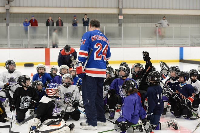 New York Rangers player alumni retired NHL player Chris Kotsopoulos gives instruction and encouragement to members of the Old Bridge Jr. Knights Youth Ice Hockey program.