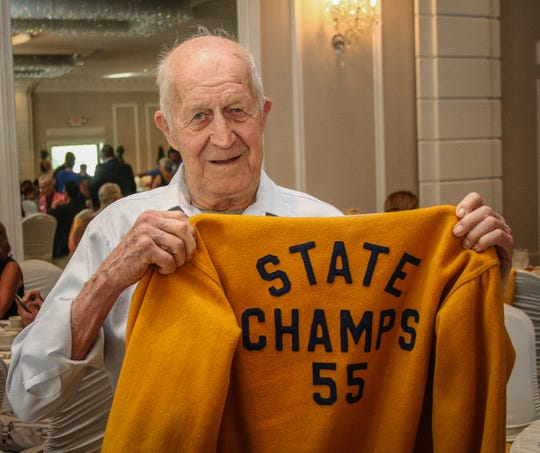 Frank Stachik of Holland Township brought a memento of playing right guard on the Frenchtown High championship football team of 1955.