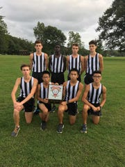 The Old Bridge boys cross country team poses after winning the GMC Red Division race on Sept. 24.