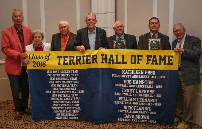 Guests of honor at the Terrier Hall of Fame induction banquet included, from left to right, Bob Hampton, Kathleen Pegg, Nick Fleming, Dave Brown, Terry LaFevre, Willie Leonardi and Ben Hodgson, coach of the Frenchtown High championship basketball team of 1954-55.