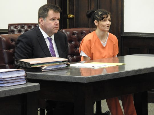 Attorney David Hanson with client Anne Morehart Tuesday in Coshocton County Common Pleas Court. She received 18 months in prison for trafficking in methamphetamine.
