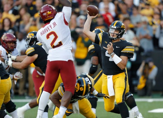 Iowa State linebacker Willie Harvey, left, pressures Iowa quarterback Nate Stanley during the second half of an NCAA college football game, Saturday, Sept. 8, 2018, in Iowa City, Iowa. Iowa won 13-3.