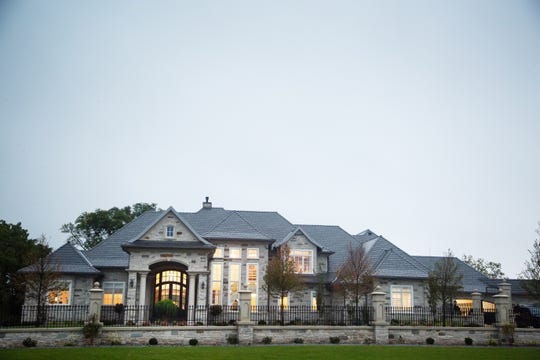 Dennis Albaugh and his wife, Susan, have built a slightly smaller version of their former home — 8,773 square feet —on the southern end of the Talons of Tuscany golf course in Ankeny.