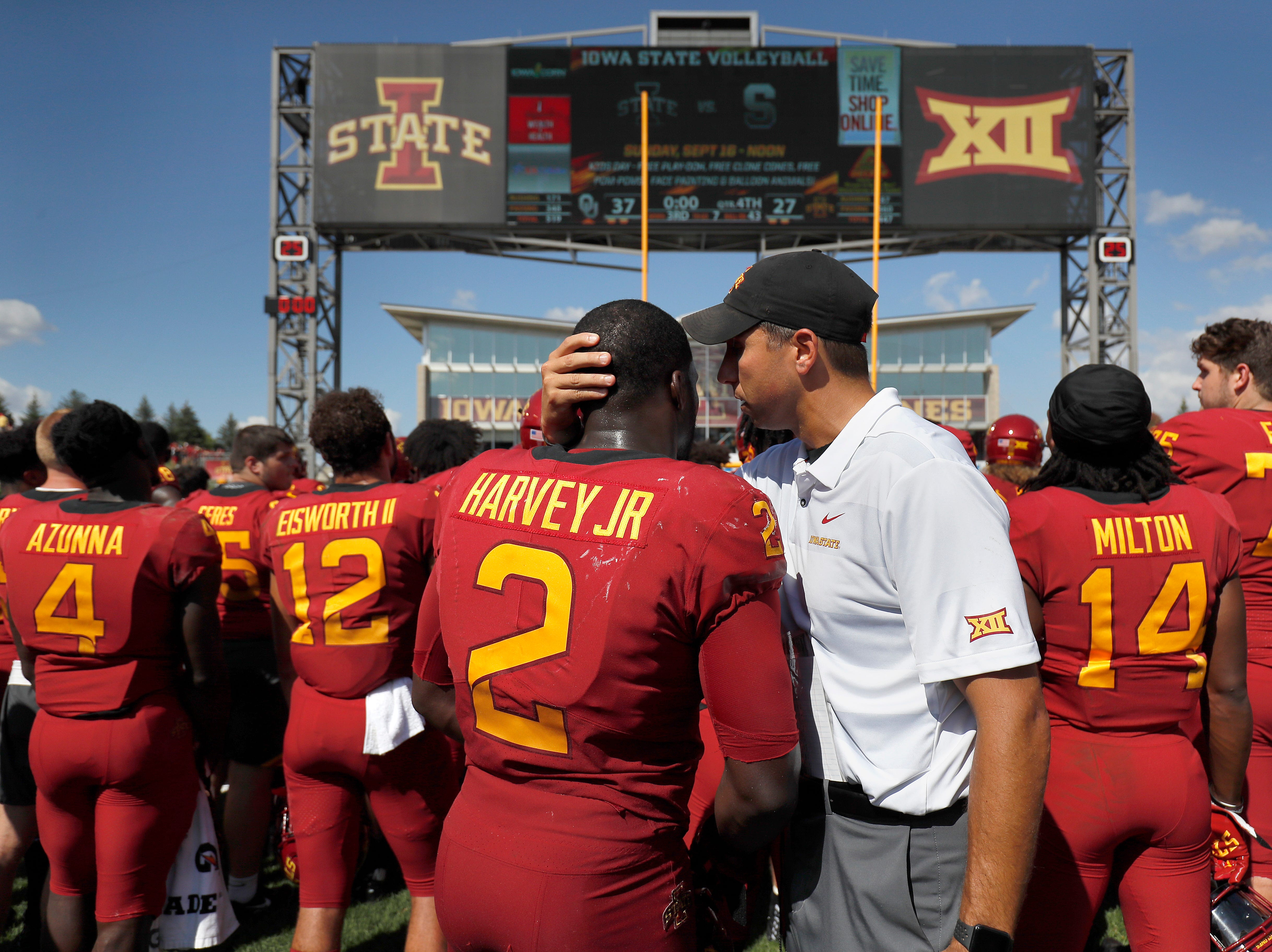 Iowa State head coach Matt Campbell, right, pulls Iowa State linebacker Willie Harvey, left, aside after their 37-27 loss to Oklahoma in an NCAA college football game Saturday, Sept. 15, 2018, in Ames, Iowa.