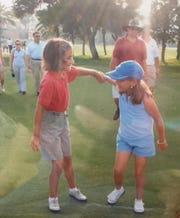 Isabel Bascuas, 7, and Celia Barquin Arozamena, 7, meet each other at a Spanish golf tournament they played in.