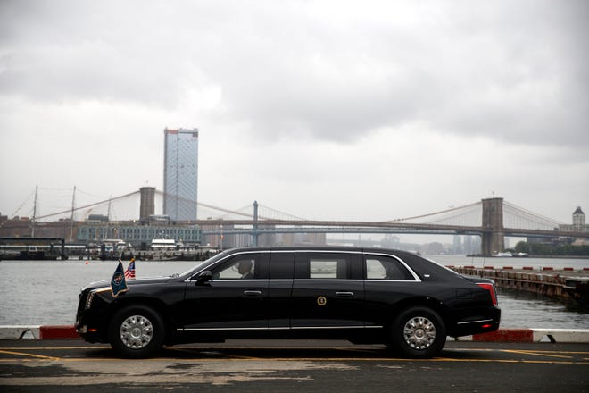 """The presidential limo, a Cadillac, at the Downtown Manhattan Heliport before the arrival of President Donald Trump, Sunday, Sept. 23, 2018, in New York. A sleeker version of the armored presidential limousine known as """"the Beast"""" is ferrying Trump around midtown Manhattan."""
