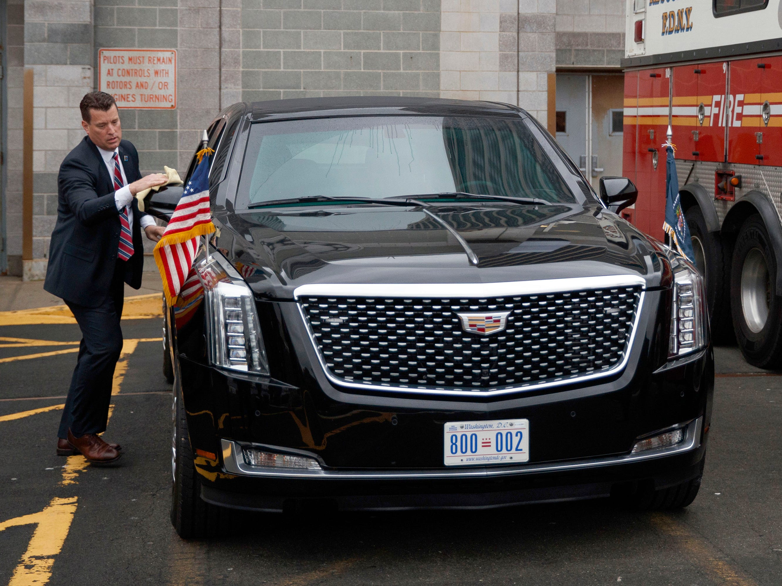 The new presidential limousine by Cadillac on Sept. 23, 2018 in New York. A Secret Service agent cleans the limousine before the arrival of Marine One carrying President Donald Trump at the Downtown Manhattan Heliport in New York.